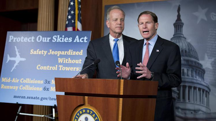 Sen. Jerry Moran, R-Kansas listens at left, as Sen. Richard Blumenthal, D-Conn. speaks to reporters about Federal Aviation Administration (FAA) spending cuts, Tuesday, April 23, 2013, on Capitol Hill in Washington.  (AP Photo/Manuel Balce Ceneta)