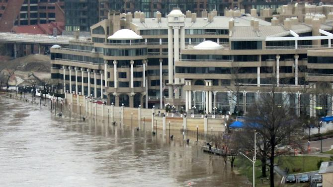 This March 14, 2010 photo provided by architect Arthur Cotton Moore shows flood gates Moore designed protecting the Washington Harbour complex in the Georgetown area of Washington from waters overflowing from the Potomac River. (AP Photo/Arthur Cotton Moore)
