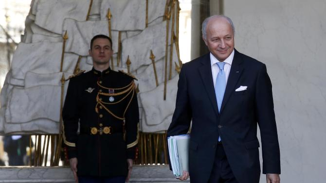 French Foreign Affairs Minister Laurent Fabius leaves the Elysee Palace following the weekly cabinet meeting in Paris