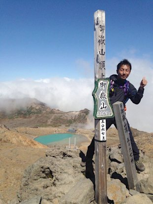 In this Saturday, Sept. 27, 2014 photo found in a smart phone possessed by 41-year-old hiker Hideomi Takahashi who fell victim to the eruption of Mount Ontake, and was uploaded on twitter by his friend Thursday, Oct. 2, Takahashi poses on the summit of Mount Ontake four minutes before the initial eruption of the volcanic mountain in central Japan.(AP Photo/Courtesy Hideomi Takahashi)