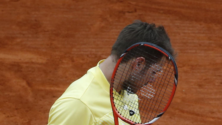 Stanislas Wawrinka of Switzerland, reacts after losing a point against Roger Federer of Switzerland during the final match of the Monte Carlo Tennis Masters tournament in Monaco, Sunday, April 20, 2014. (AP Photo/Michel Euler)