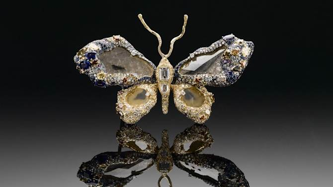 """This undated handout photo provided by The Smithsonian's National Museum of Natural History shows one side of the """"Royal Butterfly Brooch"""" . The museum is unveiling the newest addition to its famous gem collection with a butterfly brooch made of 2,300 gems. The """"Royal Butterfly Brooch"""" was created in 2009 by Taiwanese jewelry artist Cindy Chao. She is donating the piece to the museum, making it the first Taiwanese-designed item in the National Gem Collection. It goes on display Wednesday. The Royal Butterfly is composed of 2,328 gems, totaling 77 carats. It includes colored and color-changing sapphires and diamonds, rubies and tsavorite garnets. The centerpieces of the butterfly's wings are four large-faceted diamond slices. (AP Photo/Smithsonian's National Museum of Natural History)"""