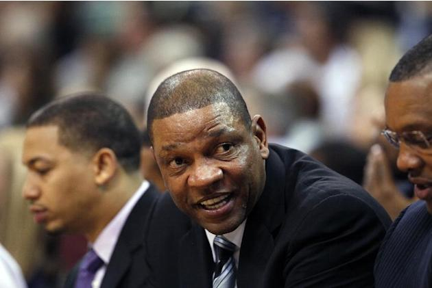 Los Angeles Clippers' head coach Doc Rivers sits on the sideline in the second half during an NBA preseason basketball game against the Utah Jazz Saturday, Oct. 12, 2013, in Salt Lake City.   The Clip