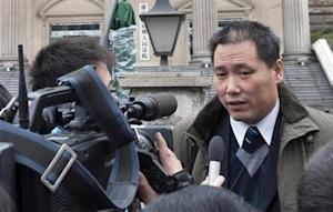 Chinese lawyer Pu Zhiqiang speaks to journalists outside courthouse in Chongqing municipality
