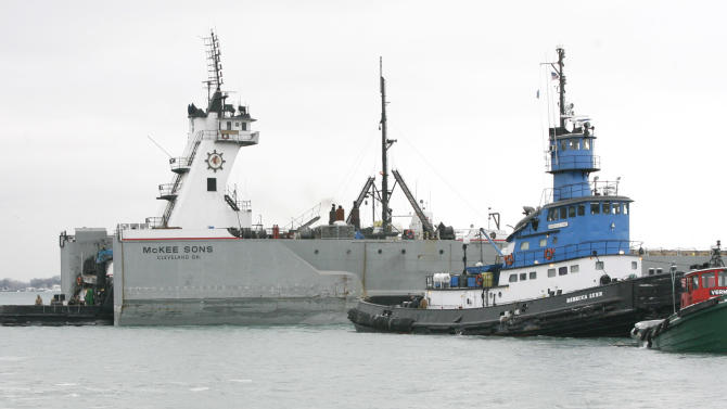 A view of some tugboats assisting a 579-foot McKee Sons freighter stuck in the Trenton Channel next to Grosse Ile, Mich., Sunday Dec. 26, 2010.  (AP Photo/The Detroit News, Madalyn Ruggiero)