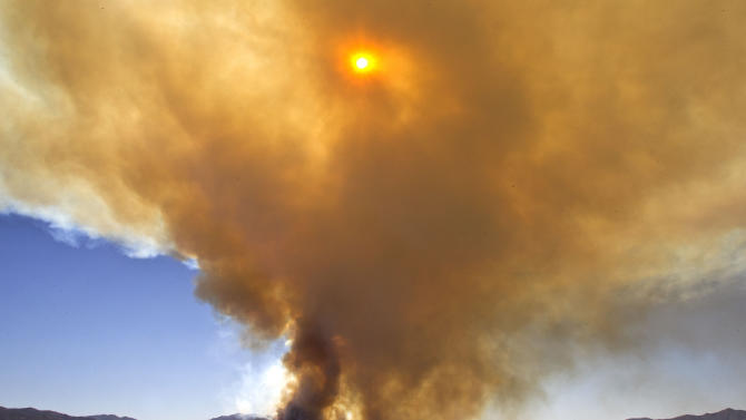 Smoke from the wild fire can be seen from Spring Valley as the sun goes down and firefighters try to protect the town of Crown King Wednesday, May 16, 2012 in Crown King, Ariz. (AP Photo/The Arizona Republic, Tom Tingle)  MARICOPA COUNTY OUT; MAGS OUT; NO SALES