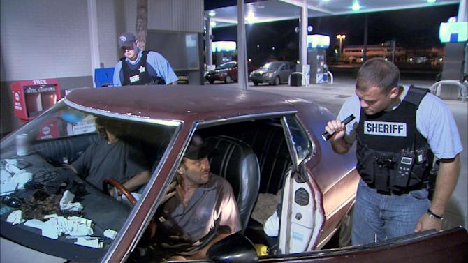 "This TV publicity image released by Fox shows police officers in Hillsborough, Fla., interrogating two occupants of a car for suspicious drug activity in the ""Liar Liar #6"" episode of ""COPS."" The Saturday night television fixture ""Cops"" is leaving Fox after 25 years to move to the Spike network. The cable network aimed at young male viewers said Monday, May 6, 2013, it will begin airing episodes in September. (AP Photo/Fox)"