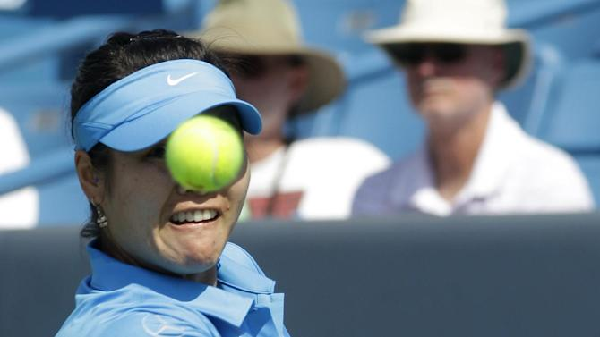 Li Na, from China, eyes a backhand during a match against Lucie Safarova, from the Czech Republic, at the Western & Southern Open, Tuesday, Aug. 16, 2011 in Mason, Ohio. (AP Photo/Al Behrman)