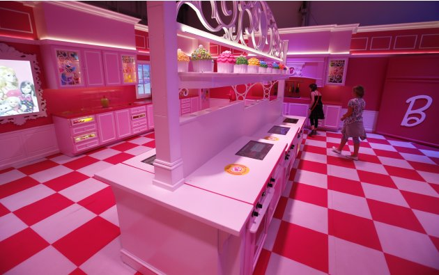 Girls watch the kitchen inside a life-size
