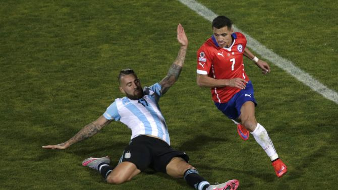 Chile's Sanchez drives the ball past Argentina's Otamendi during their Copa America 2015 final soccer match at the National Stadium in Santiago