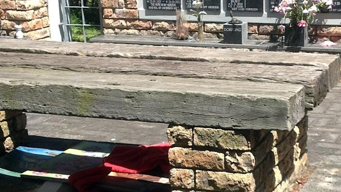 This photo released by the South African Police Service (SAPS) on Tuesday, Nov. 13, 2012, shows the four paintings stolen from a museum in its capital hundreds of miles away in a cemetery under a park bench in Port Elizabeth, South Africa. Brig. Marinda Mills of the SAPS told The Associated Press on Tuesday that officers found the paintings in Port Elizabeth, about 1,100 kilometers (700 miles) from Pretoria where they were stolen. (AP Photo/South African Police Service)