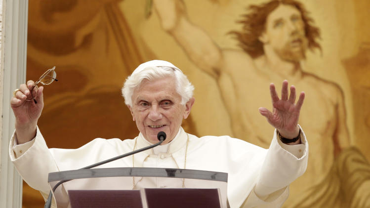 "Pope Benedict XVI waves to faithful during the Angelus prayer at his summer residence of Castel Gandolfo, in the outskirts of Rome, Sunday, July 22, 2012. Benedict XVI says he's ""deeply shocked"" by the ""senseless violence"" in the Colorado movie theater shootings and is offering his prayers so the survivors and relatives of the victims can find strength. He also said he hopes the Olympics Games starting July 27 in London will help promote peace and reconciliation in the world. (AP Photo/Riccardo De Luca)"
