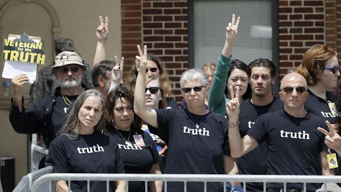 Supporters of Army Pfc. Bradley Manning flash peace signs outside of a courthouse in Fort Meade, Md., Tuesday, July 30, 2013, after Manning receiving a verdict in his court martial. Manning was acquitted of aiding the enemy, the most serious charge he face, but was convicted of espionage, theft and other charges, more than three years after he spilled secrets to WikiLeaks. (AP Photo/Patrick Semansky)