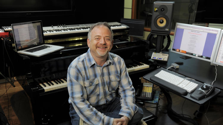 "In thsi Wednesday, Aug. 14, 2013 photo, composer Marc Shaiman poses at his home recording studio in Los Angeles. Shaiman and partner Scott Wittman are nominated for an Emmy for their song, ""Hang the Moon,"" from TV's ""Smash."" Their latest stage musical, ""Charlie and the Chocolate Factory,"" is a hit on London's West End. (Photo by Chris Pizzello/Invision/AP)"