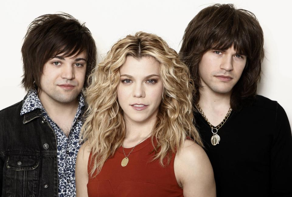 "This Jan. 23, 2013, photo shows musicians Kimberly Perry, center, Neil Perry, left, and Reid Perry, from The Band Perry in Los Angeles. The band released its sophomore album ""Pioneer"" in April.  (Photo by Matt Sayles/Invision/AP)"