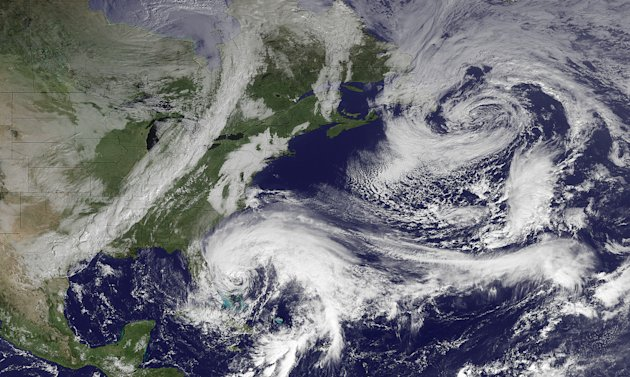 "In this image taken by NOAA's GOES East at 2:45 GMT on Friday, Oct. 26, 2012, Hurricane Sandy is seen in the center bottom. The hurricane has killed at least 20 people in the Caribbean, and just left the Bahamas. It is expected to move north, just off the Eastern Seaboard. When Hurricane Sandy becomes a hybrid weather monster some call ""Frankenstorm"" it will smack the East Coast harder and wider than last year's damaging Irene, forecasters said Friday. (AP Photo/NOAA)"