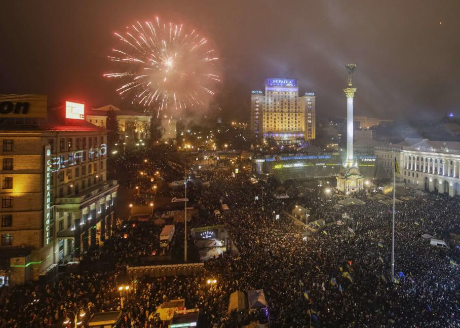 Fireworks explode over Independence Square where pro-European integration supporters take part in New Year celebrations, in central Kiev