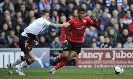 Cardiff City's Fraizer Campbell (R) is challenged by Liverpool's Daniel Agger during their English Premier League soccer match at Cardiff City Stadium in Cardiff,