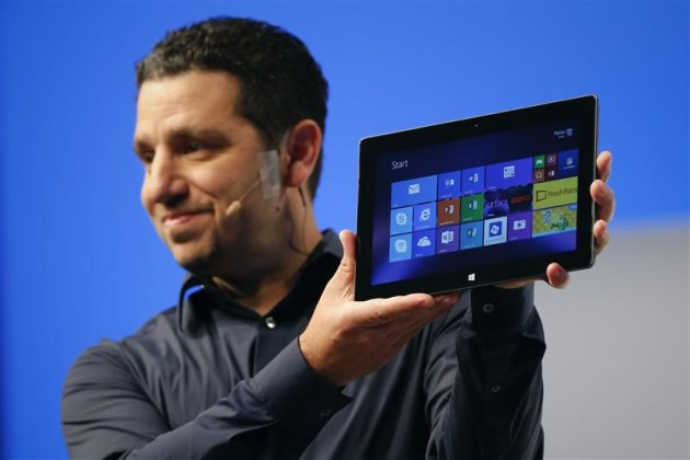 Panos Panay, Microsoft Surface general manager, holds up the Microsoft Surface Pro 2 during the launch of their Surface 2 tablets in New York September 23, 2013. REUTERS/Shannon Stapleton