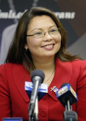 FILE - This Nov. 7, 2008 file photo shows Illinois' Veterans Affairs Director Tammy Duckworth during a news conference in Chicago.  On Wednesday, July 6, 2011, Duckworth, an Iraq war veteran and former Assistant Secretary of Veterans Affairs, announced she plans to run for Congress from Illinois' new 8th District. (AP Photo/M. Spencer Green, File)