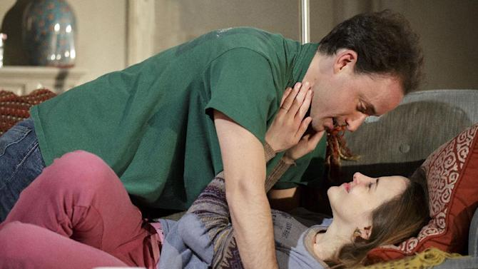"""This theater image released by Richard Kornberg & Associates shows Greg Keller, top, and Maria Dizzia in a scene from Amy Herzog's new play, """"Belleville"""", performing off-Broadway at New York Theatre Workshop in New York.  (AP Photo/Richard Kornberg & Associates, Joan Marcus)"""