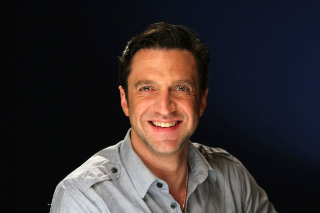 "In this April 19, 2012 photo, Raul Esparza, currently starring in the musical ""Leap of Faith"" on Broadway, is shown in New York. He plays the huckster Jonas Nightingale, whose traveling revival show gets stranded in a drought-stricken Kansas town after their bus breaks down. (AP Photo/John Carucci)"