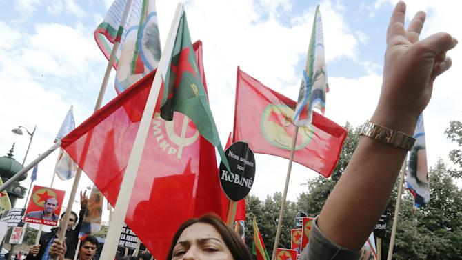 Kurdish demonstrators protest near Turkish Embassy  in Paris, France, Monday, July 27, 2015, denouncing the deaths of 32 people in a suicide bombing last Monday, in Suruc, southeastern Turkey. Turkish warplanes struck Islamic State group targets across the border in Syria early Friday, in a strong tactical shift for Turkey which had long been reluctant to join the U.S.-led coalition against the extremist group. (AP Photo/Jacques Brinon)