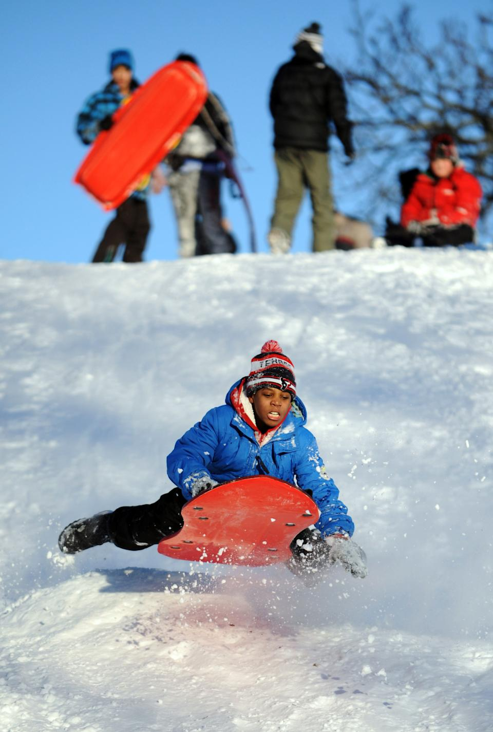 A.J. Cooper sleds on a hill in Cummings Park, Saturday, Feb. 9, 2013, in Stamford, Conn. (AP Photo/The Stamford Advocate, Lindsay Perry)  MANDATORY CREDIT; MAGS OUT
