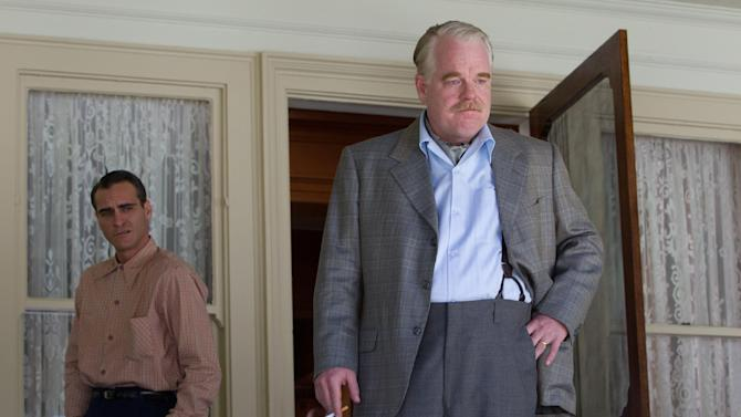 "FILE- This publicity film image released by The Weinstein Company shows Joaquin Phoenix, left, and Philip Seymour Hoffman in a scene from ""The Master.""  Films such as Ben Affleck's ""Argo"" and Joaquin Phoenix and Philip Seymour Hoffman's ""The Master"" already are proven Oscar contenders through rapturous reactions from festival crowds or early theatrical audiences. (AP Photo/The Weinstein Company, File)"