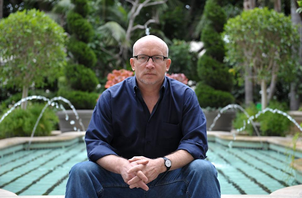 "In this Wednesday, April 24, 2013 photo, Alex Gibney poses for a portrait at the Four Seasons in Los Angeles. Gibney is the director of the documentary film, ""We Steal Secrets: The Story of WikiLeaks,"" releasing in the US on May 24, 2013. (Photo by John Shearer/Invision/AP)"