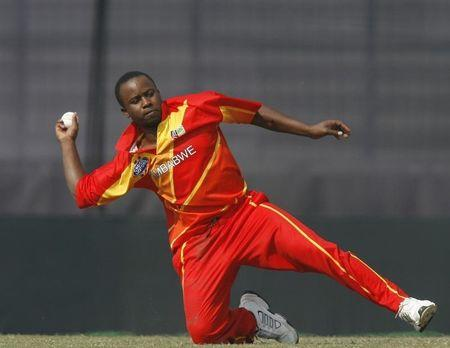 Zimbabwe's Utseya catches a ball during the tri-series one-day international cricket tournament against Bangladesh in Dhaka