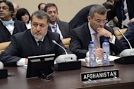 Afghanistan&#39;s Defence Minister Bismellah Mohammadi (L) waits prior to the start of the North Atlantic Council meeting of Ministers of Defense and ISAF partners at NATO headquarters in Brussels on February 22, 2013. NATO may station up to 12,000 troops in Afghanistan to train and assist Kabul&#39;s forces after its combat mission against the Taliban ends there in 2014, US officials said Friday