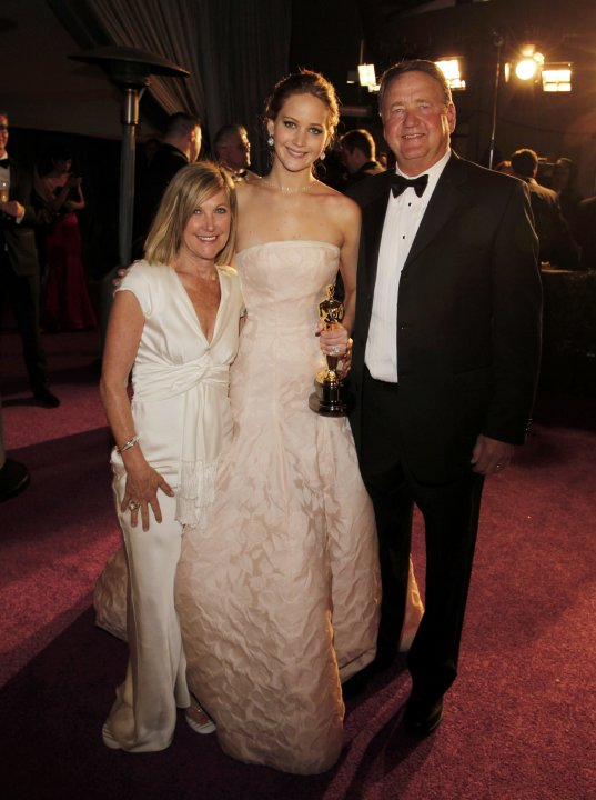Jennifer Lawrence poses with her parents after she won the Oscar for best actress following the 85th Academy Awards in Hollywood