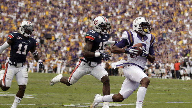 LSU wide receiver Rueben Randle (2) scores on a 46-yard pass play as Auburn cornerback Chris Davis (11) and defensive back Neiko Thorpe (15) pursue during the second quarter of an NCAA college football game in Baton Rouge, Saturday, Oct. 22, 2011. (AP Photo/Gerald Herbert)