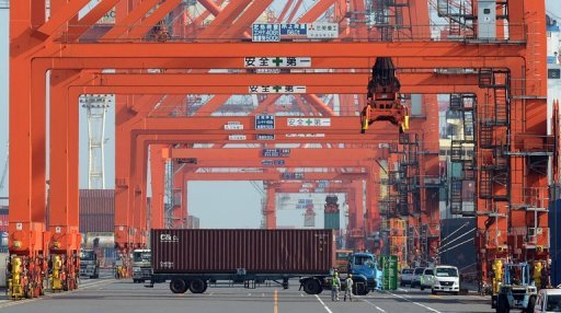 <p>This file photo shows a trailer truck carrying a container at a pier in Tokyo, in September. Japan posted its worst September trade figures in more than three decades, official data showed on Monday, as the global slowdown and a territorial spat with China weighed on overseas shipments.</p>