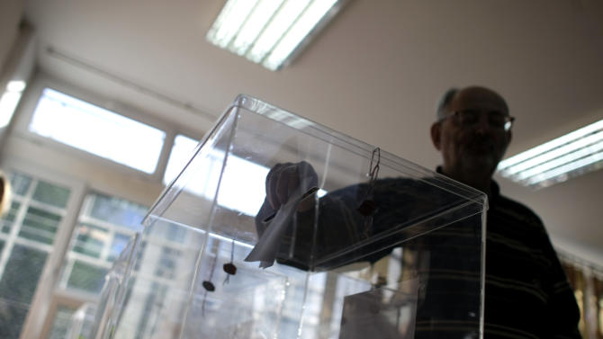 A man casts his ballot at a polling station during the elections in Belgrade, Serbia, Sunday, May 6, 2012. Serbia, a landlocked nation of 7.1 million people in southeast Europe, is holding presidential, parliamentary and municipal elections Sunday. Whoever wins could affect Serbia's future relations with the European Union as well as Kosovo, a one-time province whose declaration of independence Serbia has refused to accept. (AP Photo/ Marko Drobnjakovic)