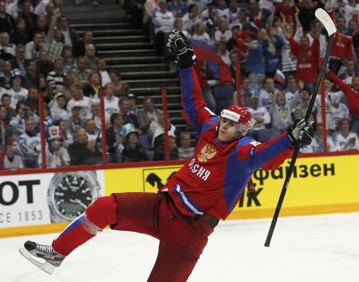 Russia's Malkin celebrates after scoring against Slovakia during their 2012 IIHF men's ice hockey World Championship final game in Helsinki