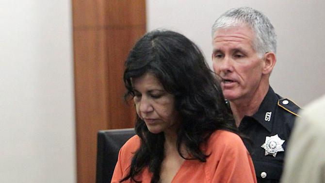 In this Tuesday, June 11, 2013 photo, Ana Lilia Trujillo left, is escorted by a bailiff from Judge Brock Thomas' 338th State District Court, in Houston. A prosecutor says Trujillo accused of stabbing her boyfriend to death with her stiletto heel had been drinking tequila with him at a nightclub earlier. (AP Photo/Houston Chronicle, James Nielsen) MANDATORY CREDIT