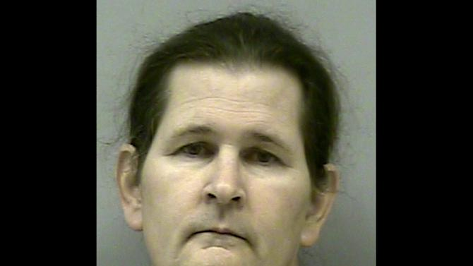 This undated photo provided by the Gwinnett Police shows Lauren Brown. Brown, 55, is the gunman that held four firefighters hostage for hours in his suburban Atlanta home, demanding that his utilities be restored, before being shot dead by a SWAT officer. (AP Photo/Gwinnett Police)