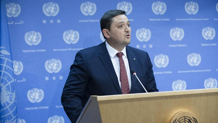 """Ambassador Oleksandr Pavlichenko, Deputy Permanent Representative of Ukraine, speaks during a news conference to discuss the crisis in Ukraine, Friday, Aug. 22, 2014, at United Nations headquarters. Russia sent more than 130 aid trucks rolling into rebel-held eastern Ukraine on Friday without Kiev's approval, saying it had lost patience with the Ukrainian government's stalling tactics. Ukraine called the move a """"direct invasion"""" that aimed to provoke an international incident. (AP Photo/John Minchillo)"""