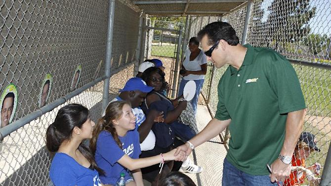 """COMMERCIAL IMAGE - Baseball All-Star Aaron Boone coach the SUBWAY National Little League Appreciation Game for the Challenger Division as they launch the national """"Buddy Badge"""" program on Wednesday, June 27, 2012 in Los Angeles. (Photo by Joe Kohen/Invision for Subway/AP Images)"""