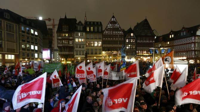 Opponents of the movement of Patriotic Europeans Against the Islamisation of the West (PEGIDA) demonstrat against PEGIDA at Roemer landmark in Frankfurt