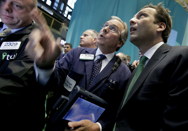 FILE- In this Sept. 20, 2012, file photo, Trulia co-founder and CEO Pete Flint, right, talks with trader Thomas Kay, center, on the floor of the New York Stock Exchange. Asian stocks mostly drifted lower Monday, Sept. 24, as investors' growing concerns about the shaky global economy overpowered any remaining optimism over central bank stimulus efforts. (AP Photo/Richard Drew, File)
