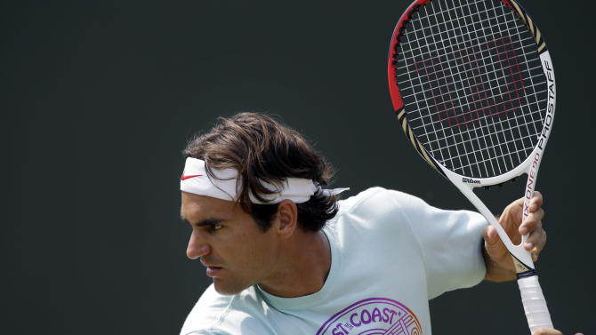 Roger Federer of Switzerland practices at the All England Lawn Tennis Club at Wimbledon, London at the 2012 Summer Olympics, Wednesday, July 25, 2012. Tennis competition is scheduled to begin Saturday, July 28. (AP Photo/Elise Amendola)