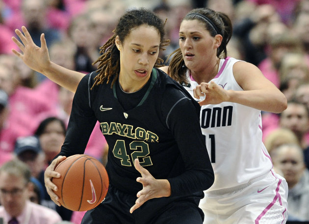 Baylor's Brittney Griner, left, is pressured by Connecticut's Stefanie Dolson during the first half of an NCAA college basketball game in Hartford, Conn., Monday, Feb. 18, 2013. (AP Photo/Jessica Hill