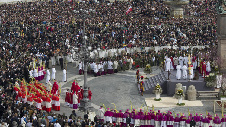 Pope Francis, right, leads the procession before the Palm Sunday Mass in St. Peter's Square at the Vatican, Sunday, March 24, 2013. Pope Francis celebrated his first Palm Sunday Mass in St. Peter's Square, encouraging people to be humble and young at heart, as tens of thousands joyfully waved olive branches and palm fronds. (AP Photo/Domenico Stinellis)