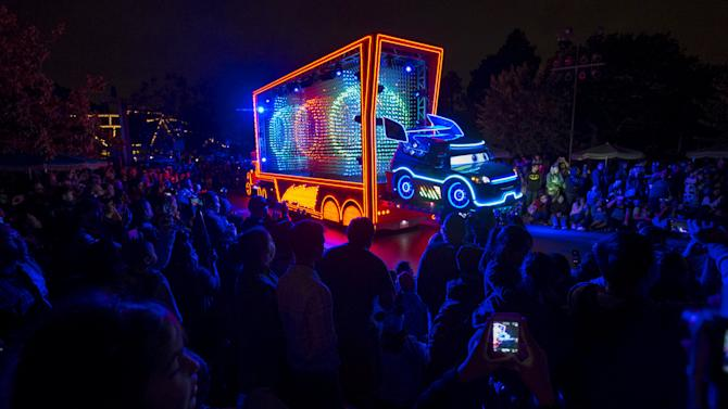 "People watch a float featuring characters from the movie ""Cars"" during the ""Paint the Night - All-New Electrical Parade"" during Disneyland Diamond Celebration in Anaheim"