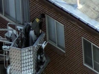Raw Video: FBI search alleged gunman's apartment