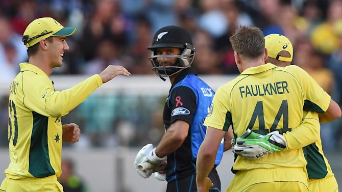 New Zealand's Grant Elliott looks at Australia's James Faulkner's on whose bowling he was dismissed during the ICC Cricket World Cup final in Melbourne, Australia, Sunday, March 29, 2015. (AP Photo/Andy Brownbill)