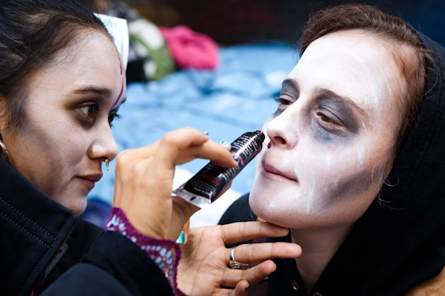 Rachel Schneider of Brooklyn, N.Y., has her face painted to resemble a zombie before a march at the ongoing Occupy Wall Street demonstration in the financial district's Zucotti park, Monday, Oct. 3, 2011, in New York. The protests have gathered momentum and gained participants in recent days as news of mass arrests and a coordinated media campaign by the protestors have given rise to similar demonstrations around the country. (AP Photo/John Minchillo)